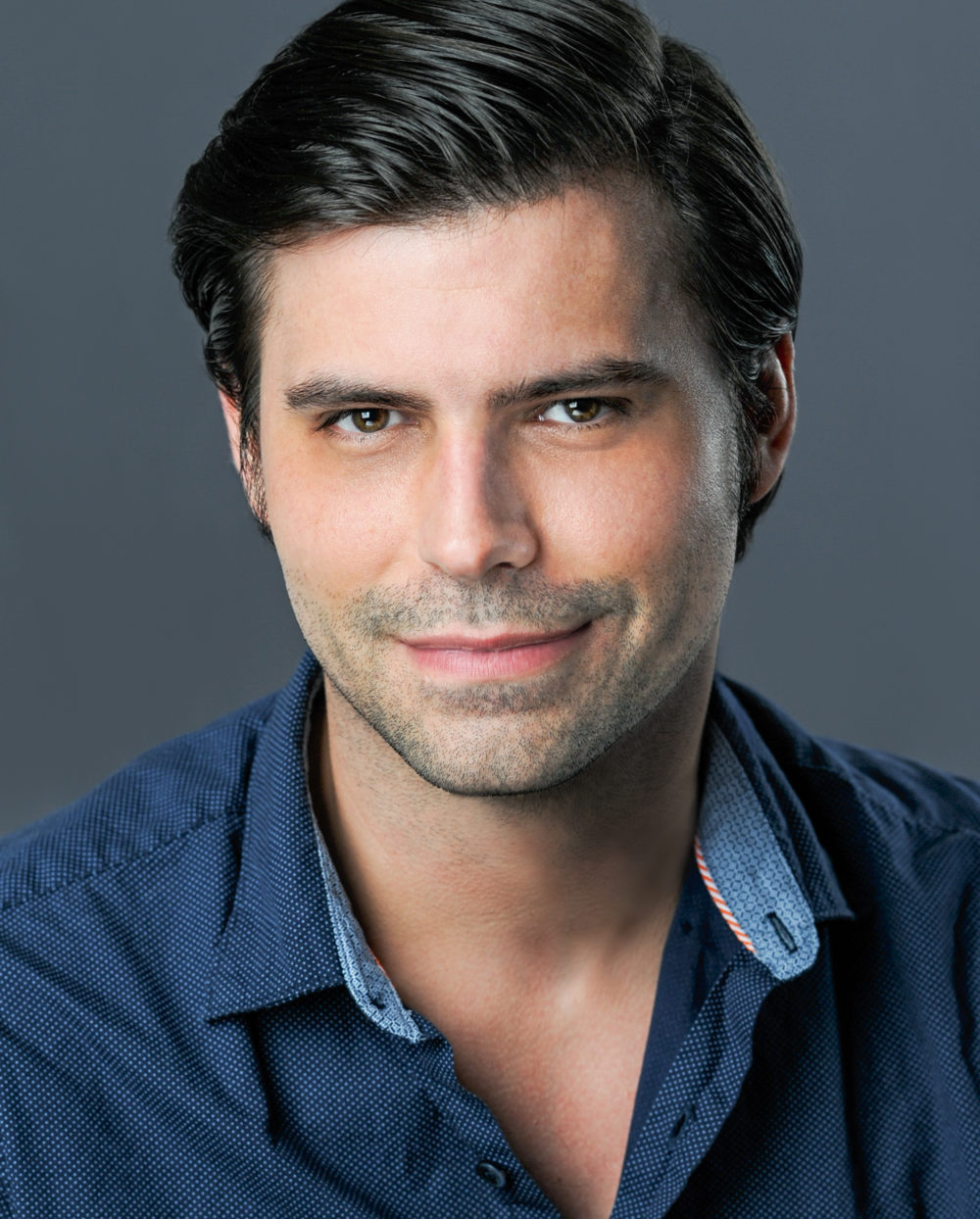 A headshot of James David West